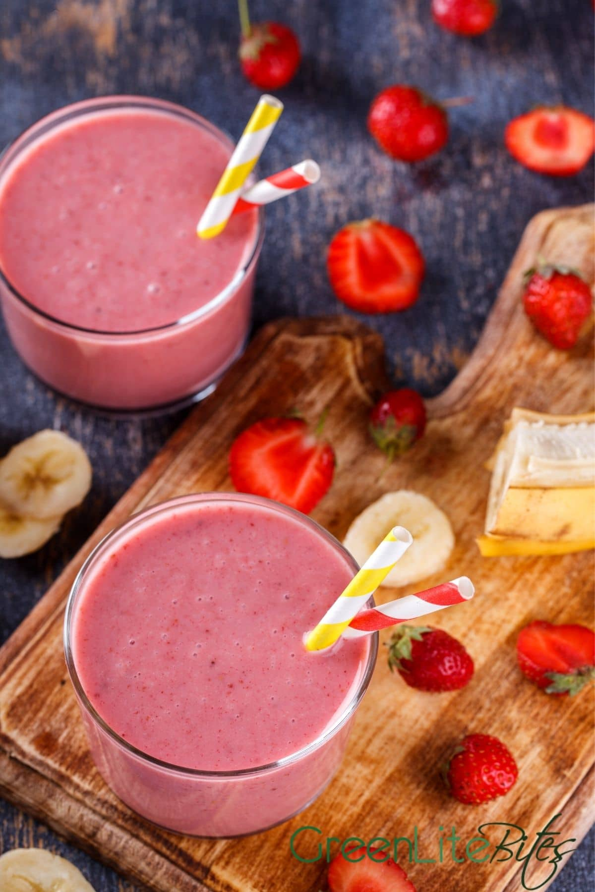 Glasses of smoothie on cutting board