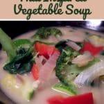 Thai vegetable soup in black bowl