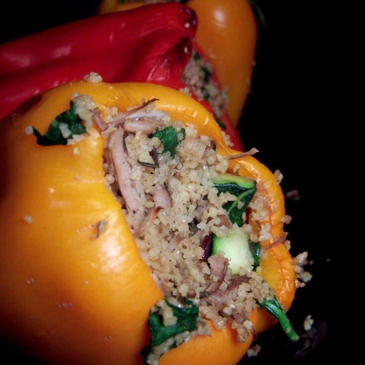 Turkey stuffed pepper on black plate