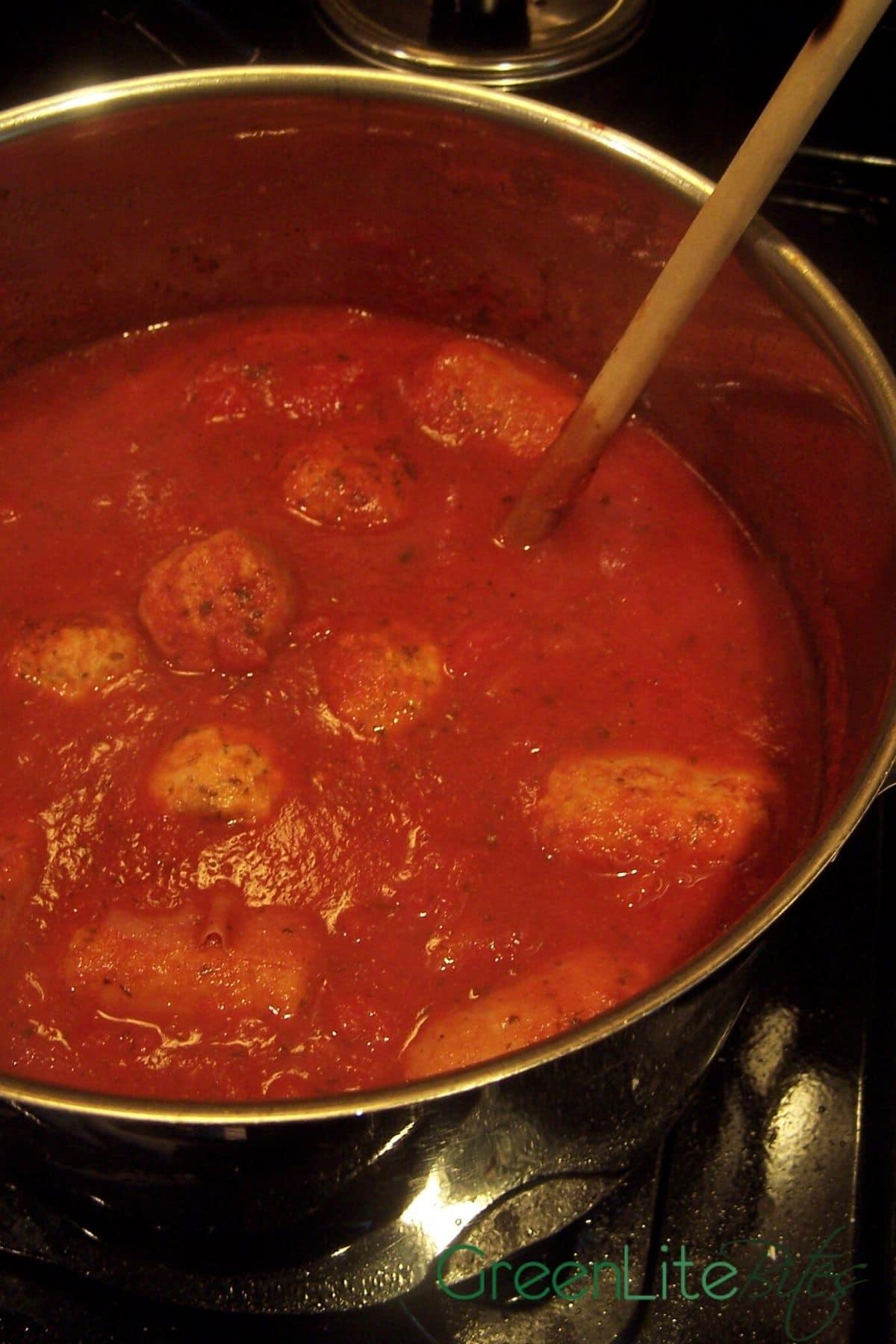 Meatballs in stockpot