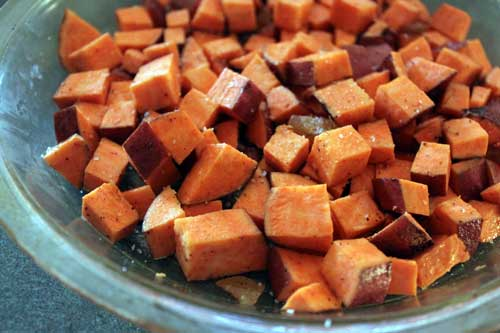 Adding the nutmeg to the sweet potatoes.