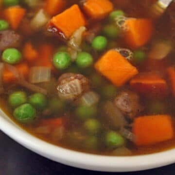 Breakfast Sausage and Sweet Potato Soup with Peas - close up