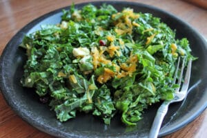 Kale and Raw Butternut Squash Salad with Feta, Walnuts and Dried Cranberries on Plate