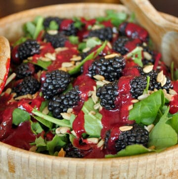 Bowl of Blackberry and Baby Greens Salad with Sunflower Seeds