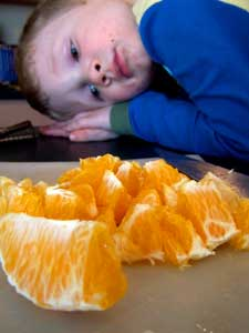 toddler with oranges