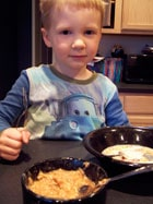 toddler eating Homemade Apple Pie Oatmeal 1