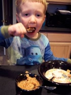 toddler eating Homemade Apple Pie Oatmeal 2