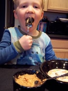 toddler eating Homemade Apple Pie Oatmeal 3
