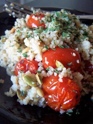 roasted tomatoes w/ couscous & pumpkin seed kernels