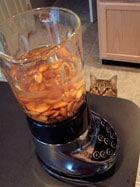 making almond milk cat watching