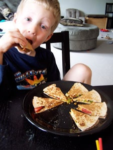 Quick Avocado Quesadilla  - toddler eating 2