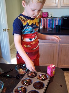Whole Wheat Chocolate Muffins with Added Protein (and Sprinkles!) - adding the sprinkles