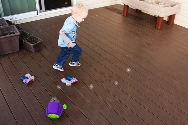 Toddler Stomping Bubbles