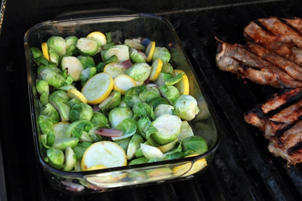 Grill Roasted Brussels Sprouts with Yellow Squash and Bacon  during cooking