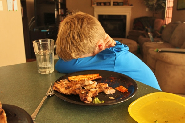 8 year old and pork chop dinner