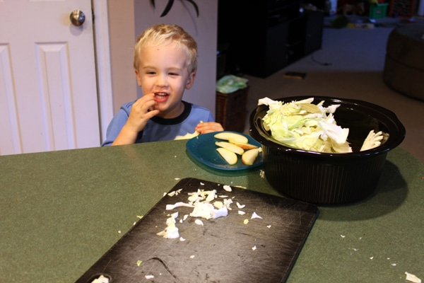 Toddler trying cabbage