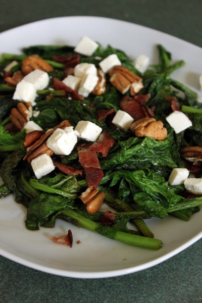 Warm Mustard Green Salad with bacon, feta and pecans