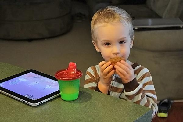 Toddler eating Butternut Squash Muffin