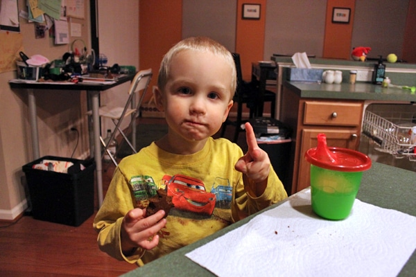 Toddler eating blender brownie