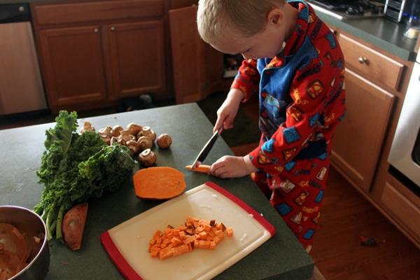 toddler cutting potato