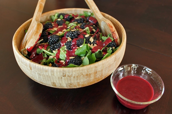 Bowl of Blackberry and Baby Greens Salad with Sunflower Seeds and Dressing