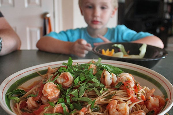 3-year-old with shrimp and spaghetti