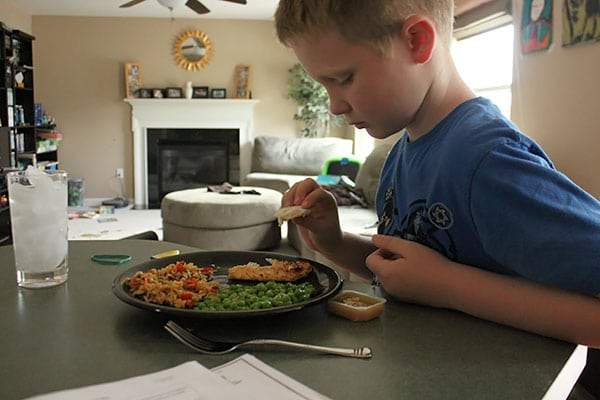 Coconut Crusted Flounder Over Pineapple Fried Rice - kid 1 reaction