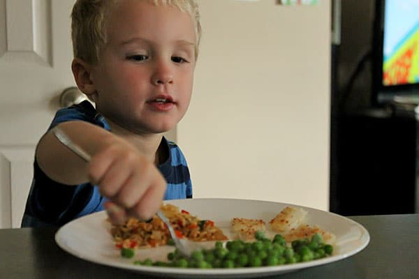 Coconut Crusted Flounder Over Pineapple Fried Rice - kid 2 reaction