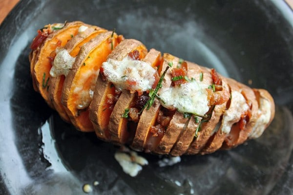 Finished Hasselback Sweet Potato With Cheddar, Chives and Bacon
