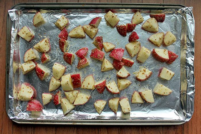 potatoes on cookie sheet.