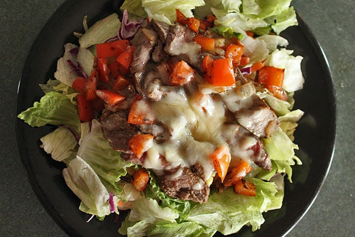 Cheesesteak Salad with a Warm Tomato Dressing - On Salad