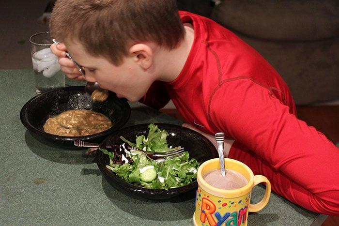 kid eating chili