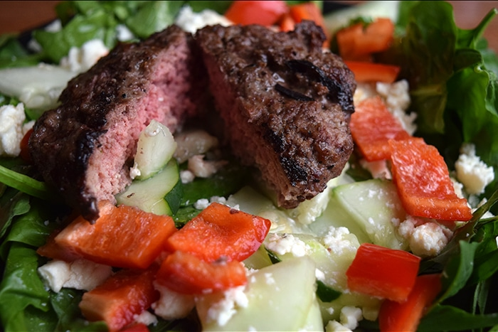 Burger Salad with Fresh Herbs and Feta Close up