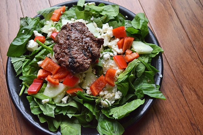 Plate of Burger Salad with Fresh Herbs and Feta\