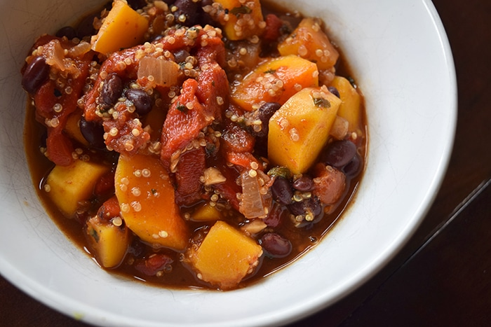 Bowl of Vegetarian Black Bean, Butternut and Quinoa Chili topped
