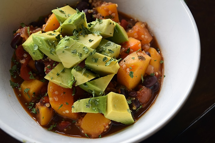Bowl of Vegetarian Black Bean, Butternut and Quinoa Chili topped with Avocado