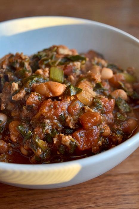 Bowl of Turkey, Collard Green and Pinto Bean Chili