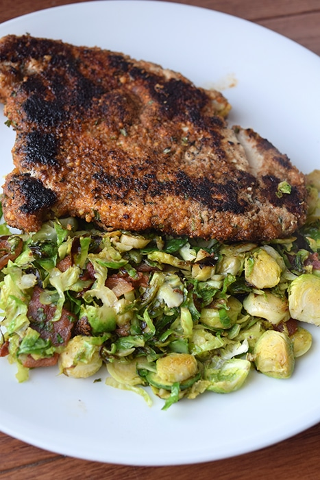Almond Crusted Chicken Breast over a Warm Brussel Sprout and Bacon Salad