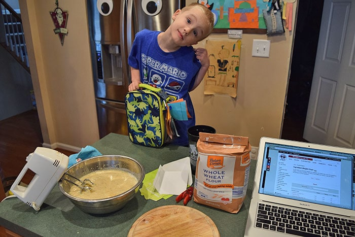 4 year old making muffins