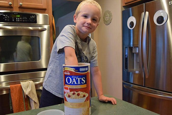 kid eating raw oatmeal