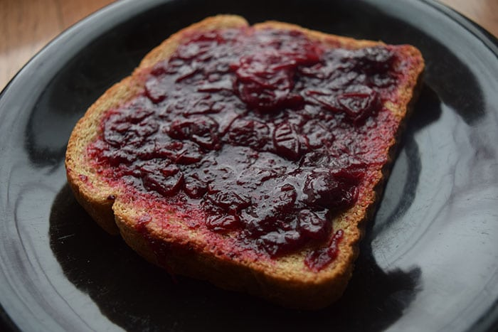 Fresh Cranberry Sauce Smeared on bread