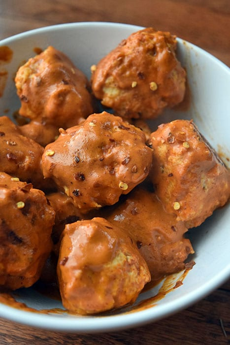 "Chicken Meatballs with Spicy ""Peanut"" Sauce"