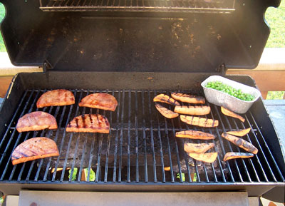 Grilled Ham Steaks with Sweet Potatoes on grill