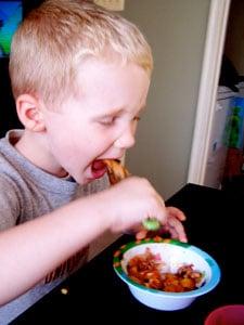 Toddler eating turk-a-roni
