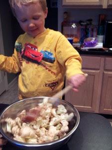 Roasted Balsamic Cauliflower - toddler mixing
