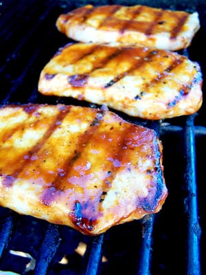 Sweet & Spicy Grilled Pork Chops on grill
