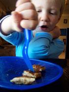 toddler eating pancakes